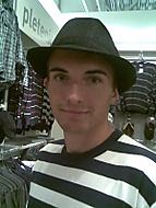 v klobouku