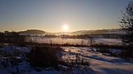 Západ slunce nad zamrzlým rybníkem (Johny M.) – Samsung Galaxy S7 Edge