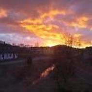 Západ slunce nad dědinou
